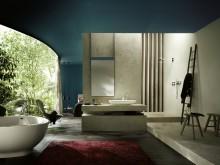 Baignoire ronde originale dans salle de bain en béton