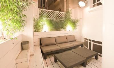 Canapé d'extérieur et ses tables basses