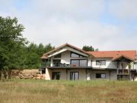 Maison bardage bois blanc