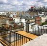 Terrasse en bois exotique sur les toits de Paris